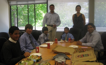 Team-and-Katherine-and-Udo-and-Amit-enjoy-pizza-with-guys-on-team-web-pic